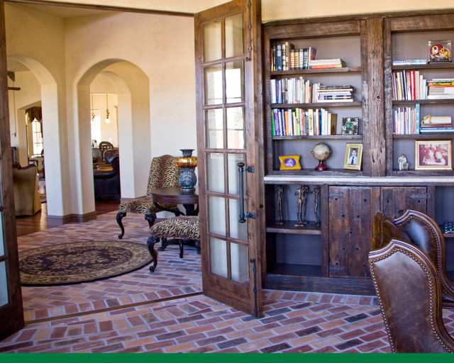 Example of a tuscan built-in desk study room design in Austin