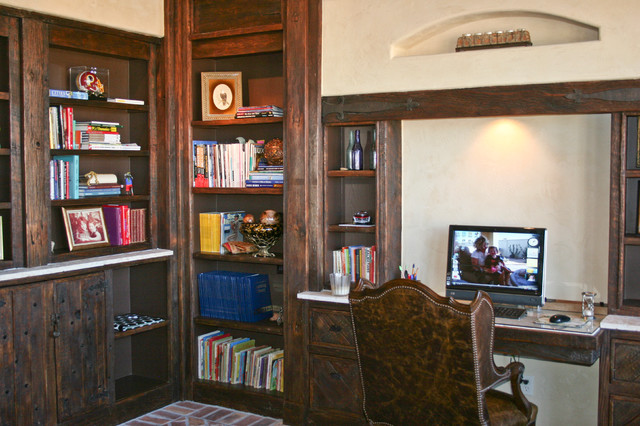 Inspiration for a rustic built-in desk study room remodel in Austin