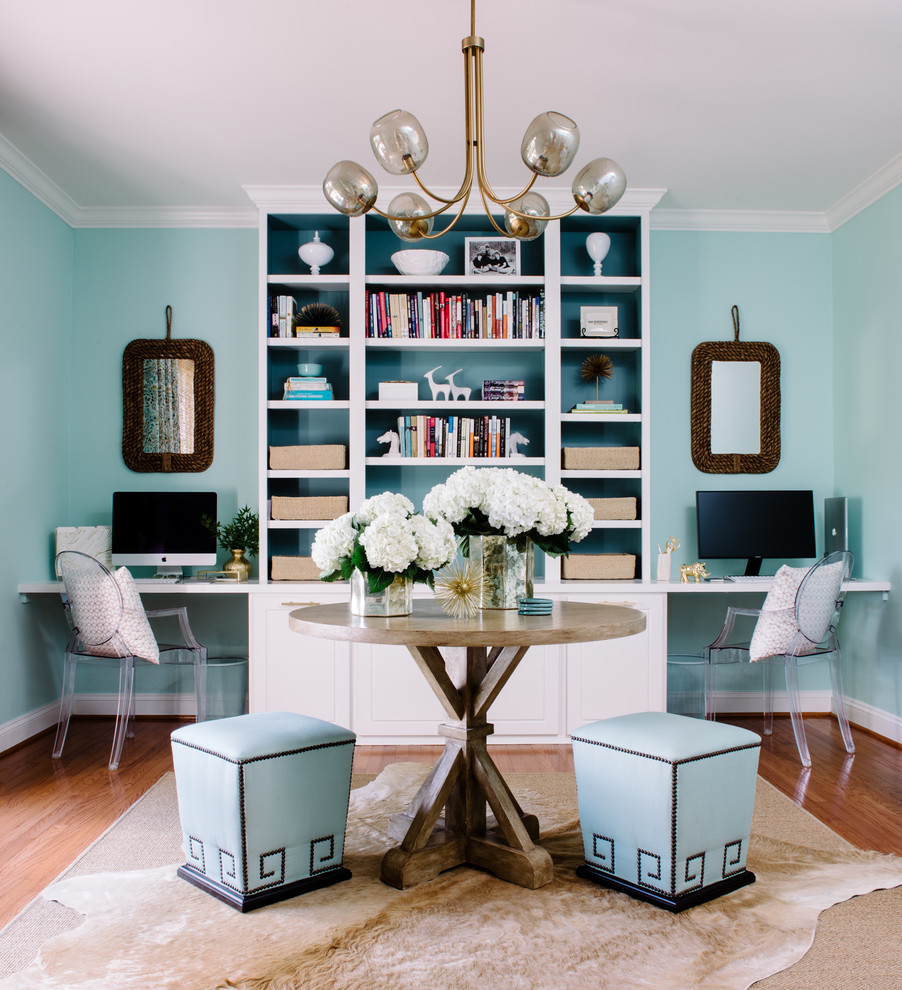 Study room - transitional built-in desk medium tone wood floor study room idea in DC Metro with blue walls and no fireplace