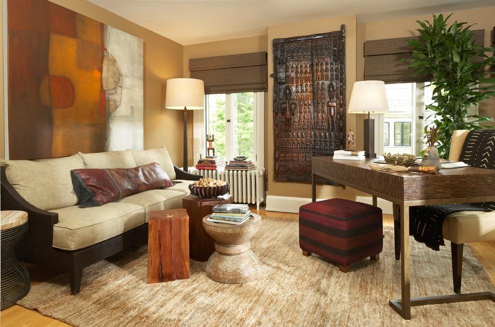 Example of a trendy freestanding desk medium tone wood floor home office design in Minneapolis with beige walls