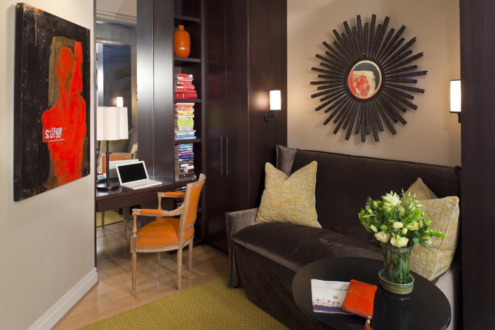 Small trendy built-in desk medium tone wood floor home office photo in DC Metro with beige walls