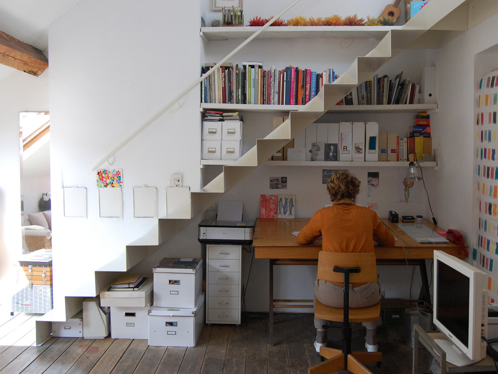 Home office - contemporary freestanding desk dark wood floor home office idea in Brussels with white walls
