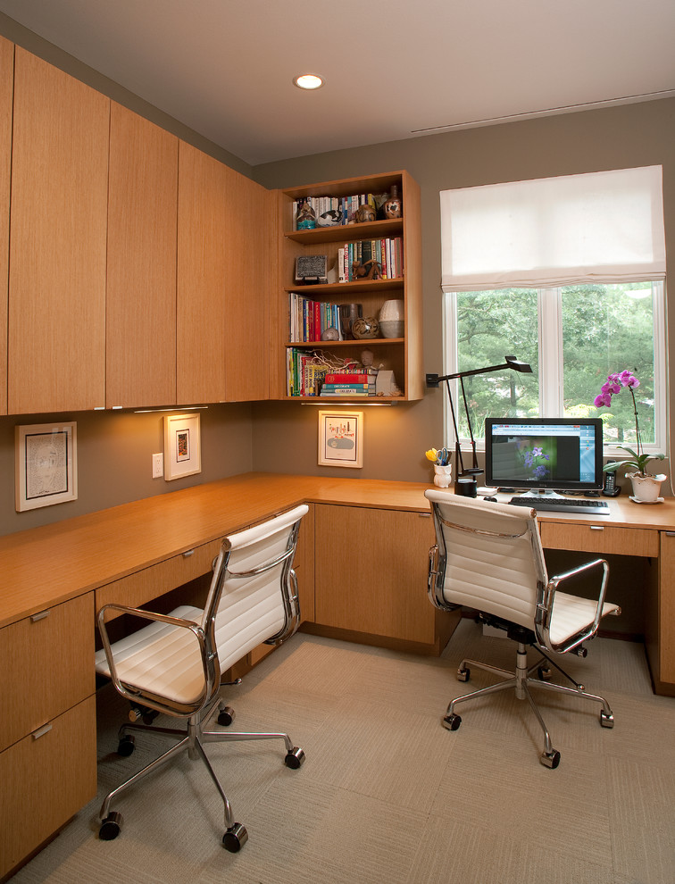 Inspiration for a contemporary built-in desk home office remodel in Milwaukee with gray walls