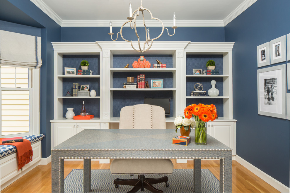 Inspiration for a mid-sized transitional freestanding desk light wood floor study room remodel in Boston with blue walls