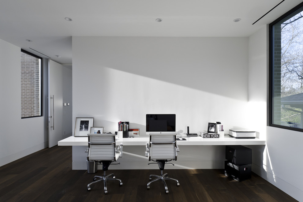 Inspiration for a modern home office remodel in Houston with white walls