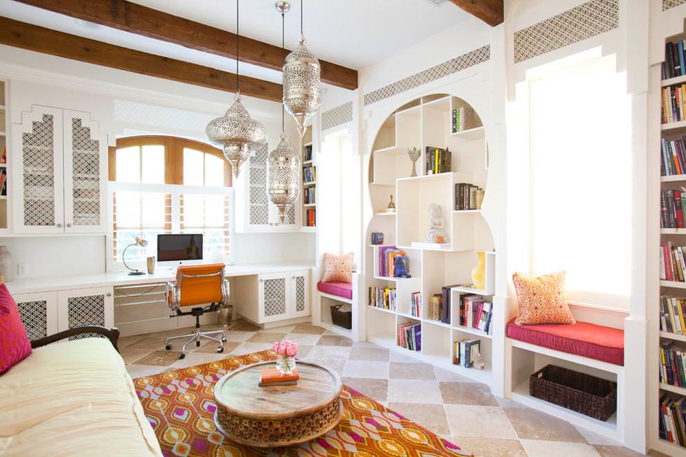 Home office - mediterranean built-in desk home office idea in Houston