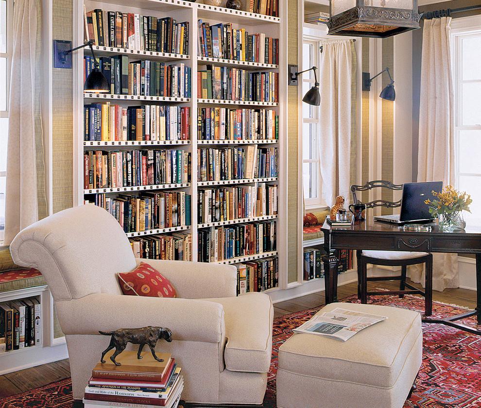 Elegant freestanding desk dark wood floor home office photo in Charleston