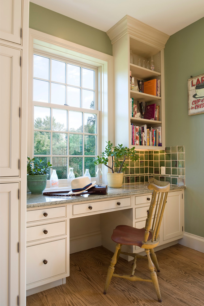 Inspiration for a cottage medium tone wood floor home office remodel in Philadelphia