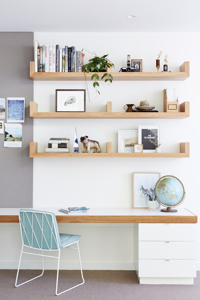 Home office - scandinavian built-in desk carpeted home office idea in Melbourne with white walls