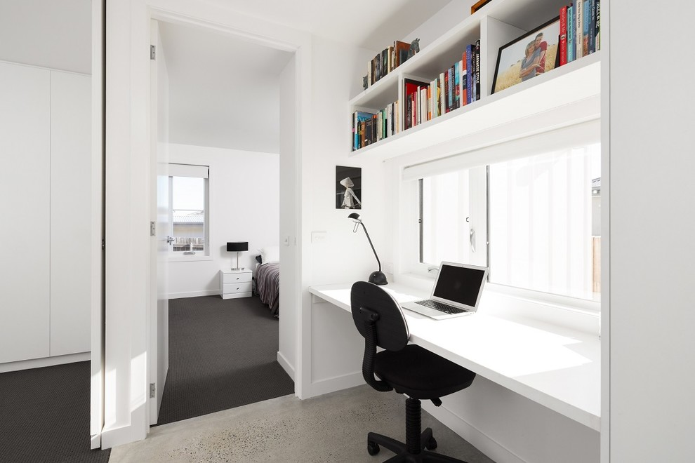 Inspiration for a scandinavian freestanding desk concrete floor study room remodel in Canberra - Queanbeyan with white walls