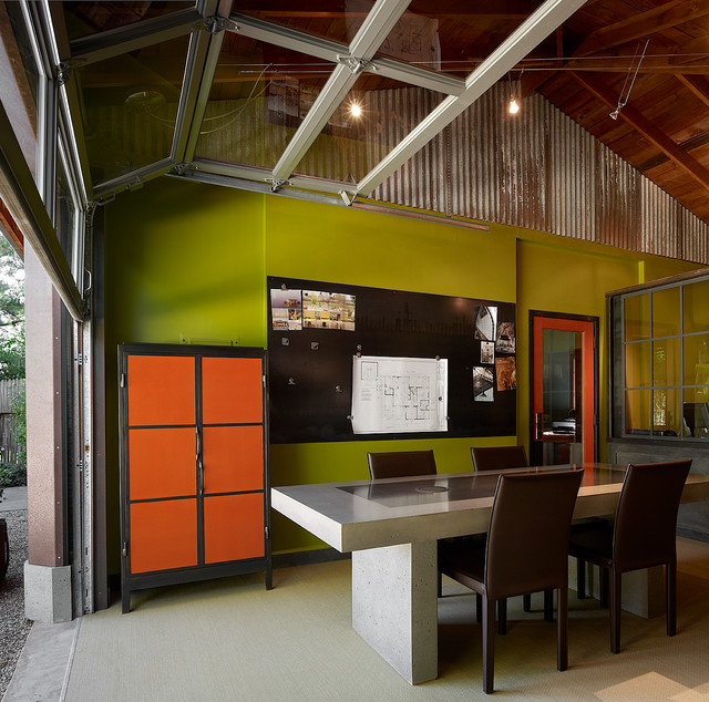 Example of a large trendy freestanding desk carpeted home studio design in  San Francisco with green
