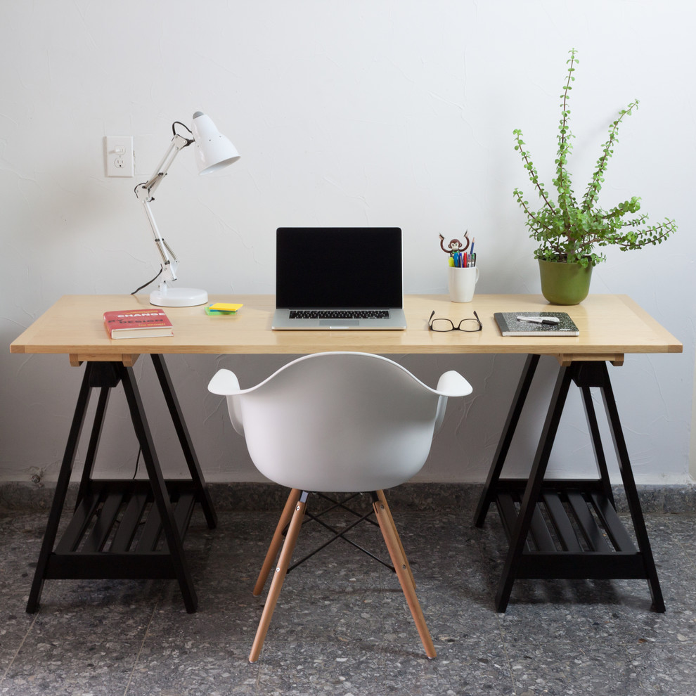 Home office - mid-sized contemporary built-in desk concrete floor home office idea in Other with white walls