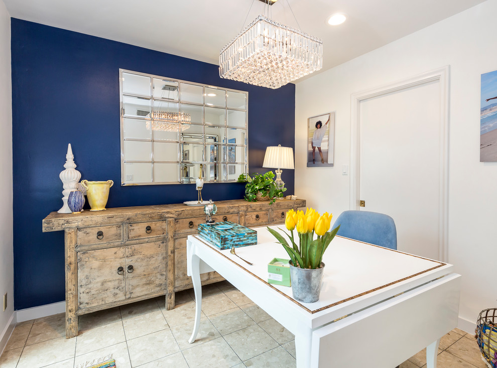 Inspiration for a small transitional freestanding desk travertine floor and beige floor craft room remodel in Los Angeles with blue walls and no fireplace