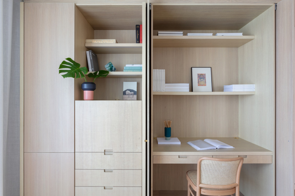 Inspiration for a small contemporary built-in desk study room remodel in Miami with no fireplace