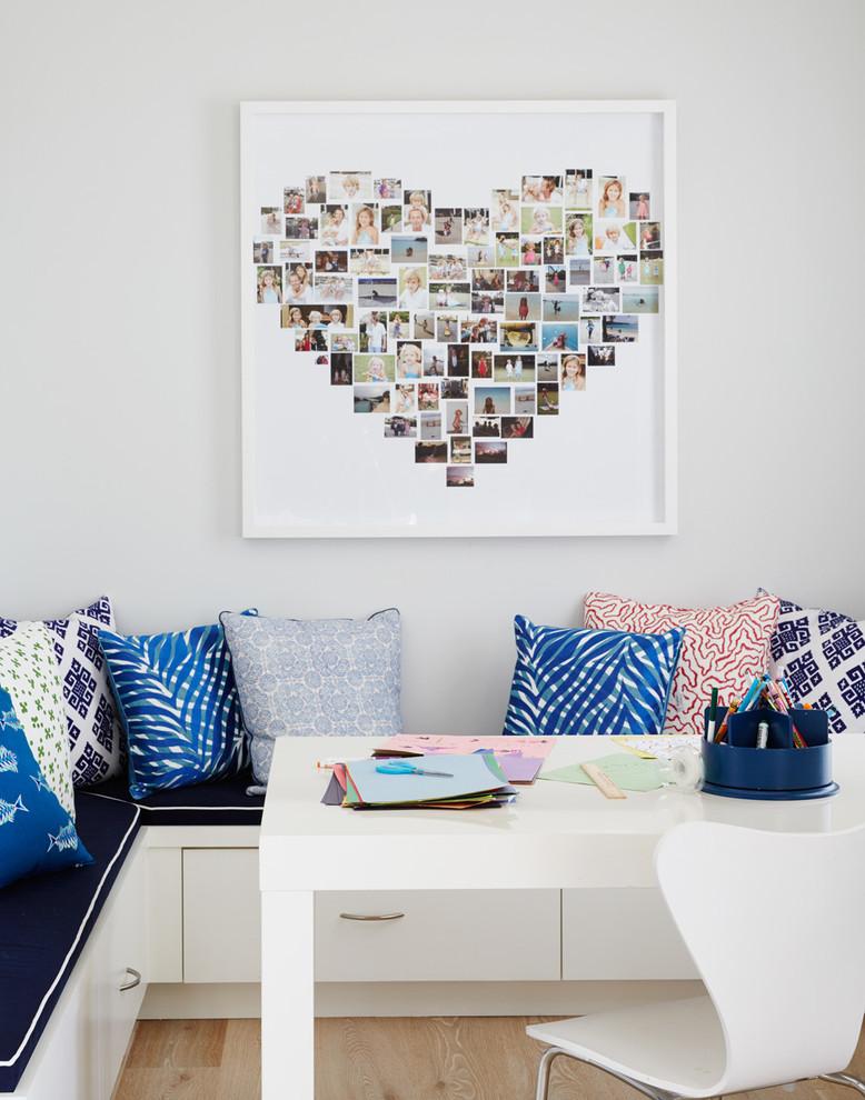 Home office - coastal freestanding desk light wood floor home office idea in Jacksonville with gray walls