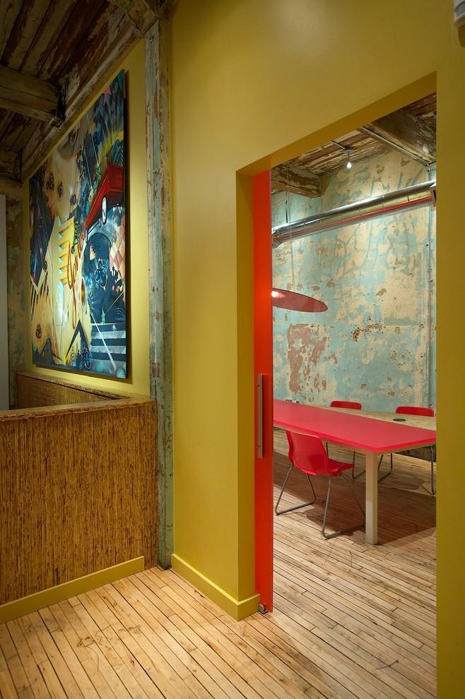 Large urban freestanding desk light wood floor home office photo in Atlanta with green walls