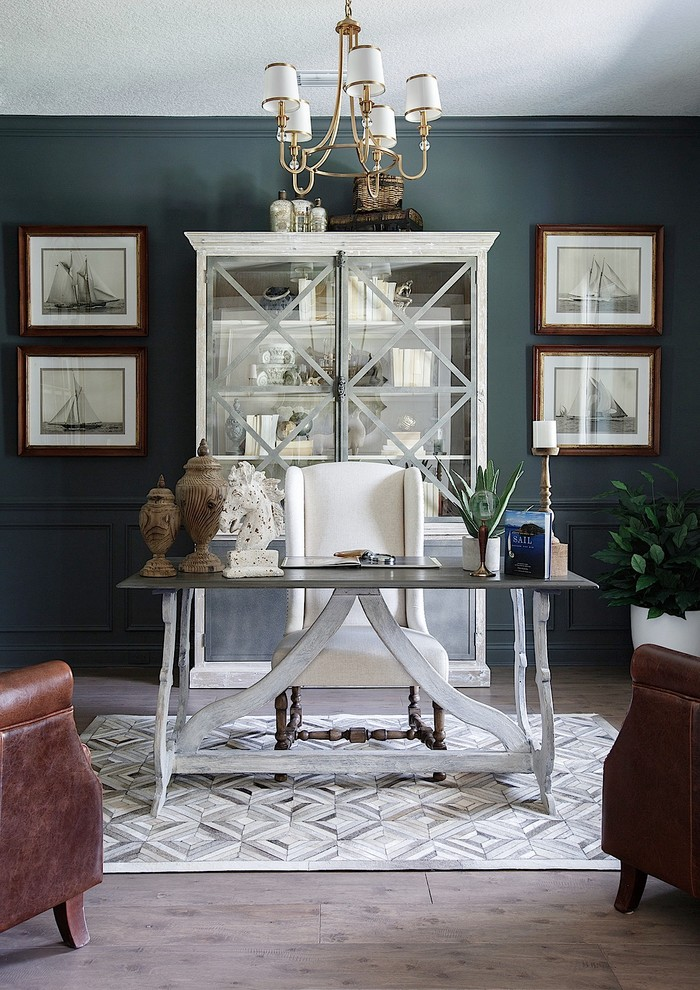 Inspiration for a mid-sized transitional freestanding desk vinyl floor and gray floor home office remodel in Jacksonville with gray walls