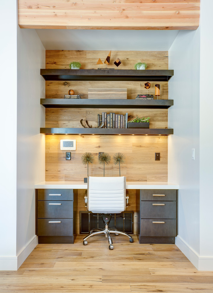 Small trendy built-in desk medium tone wood floor study room photo in Salt Lake City with white walls
