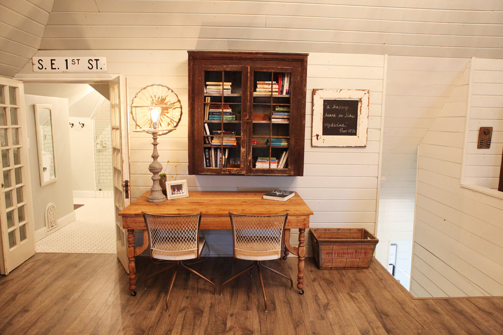 Example of a mid-sized country medium tone wood floor home office design in Austin with white walls