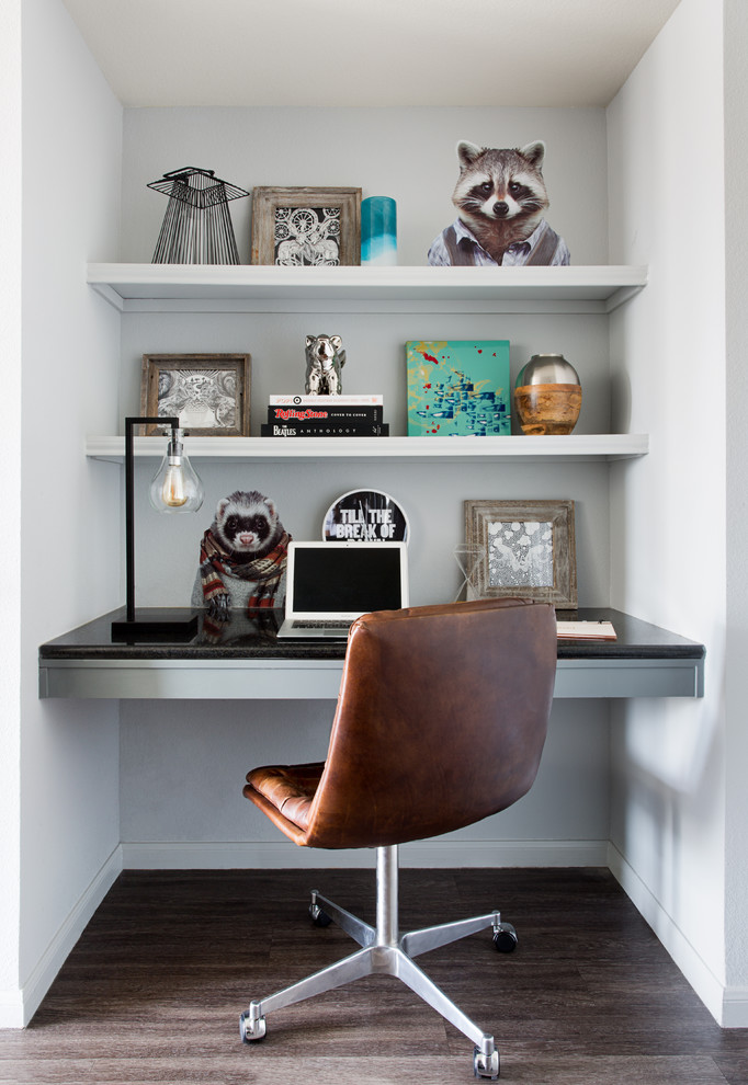 Small trendy built-in desk laminate floor study room photo in Austin with gray walls