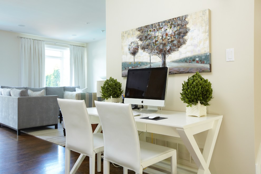 Home office - mid-sized traditional freestanding desk dark wood floor and brown floor home office idea in Toronto with beige walls