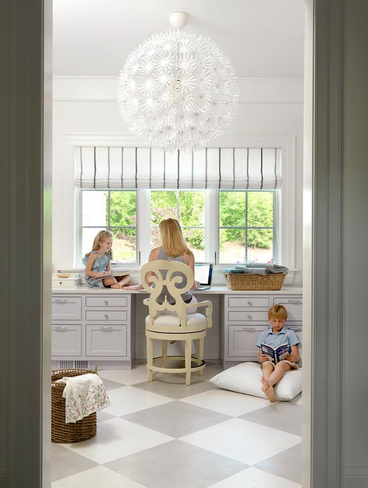 Home office - coastal built-in desk multicolored floor home office idea in St Louis
