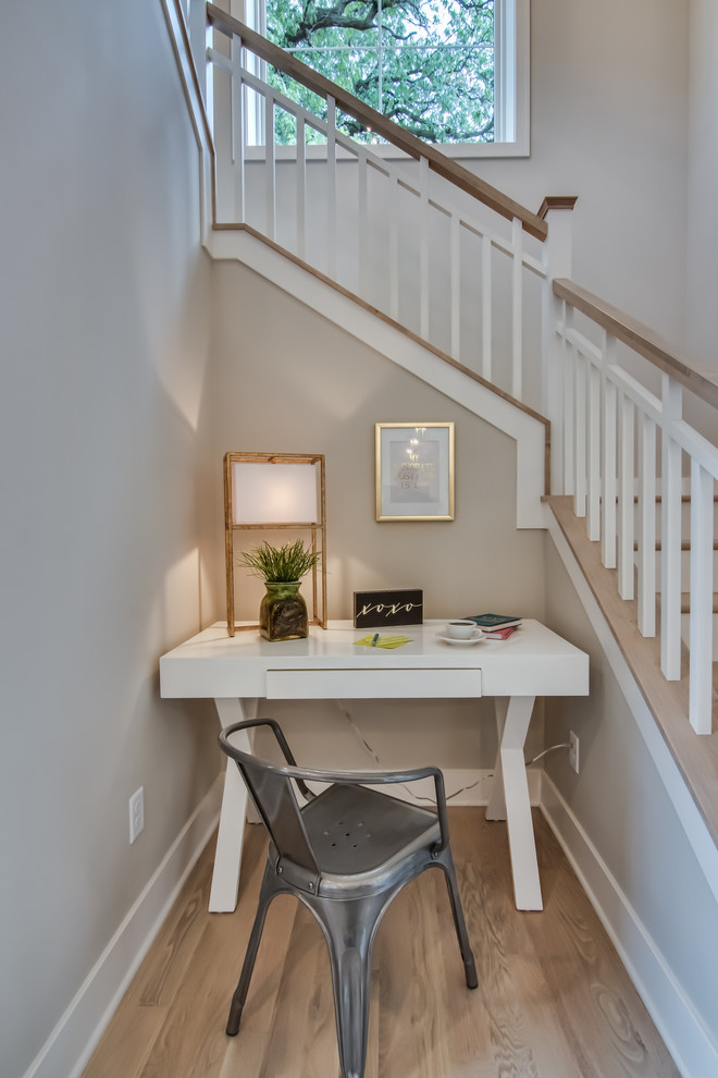 Inspiration for a small coastal freestanding desk light wood floor home office remodel in Minneapolis with no fireplace
