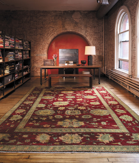 Example of a large classic freestanding desk light wood floor study room design in Boston with red walls and no fireplace