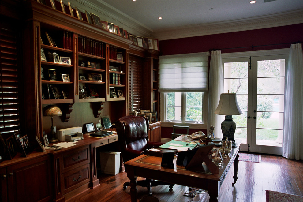 Inspiration for a large timeless freestanding desk dark wood floor home office remodel in Los Angeles with red walls