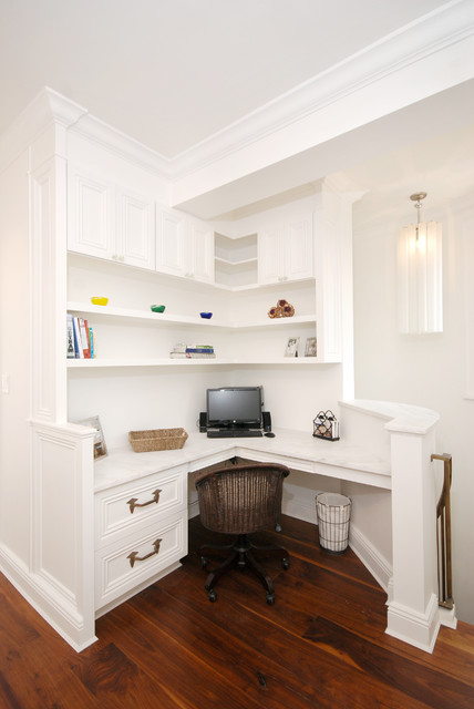 Home office - traditional built-in desk home office idea in New York