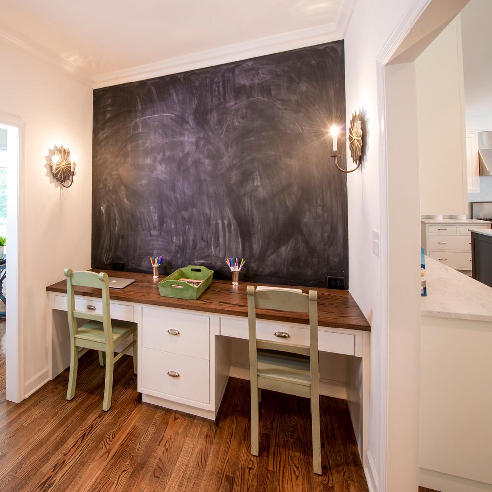Elegant built-in desk home office photo in Baltimore