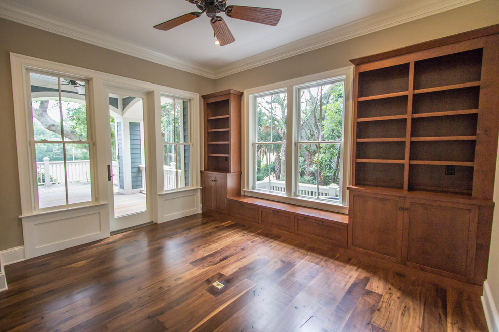 Example of a mid-sized classic freestanding desk dark wood floor study room design in Charleston with beige walls