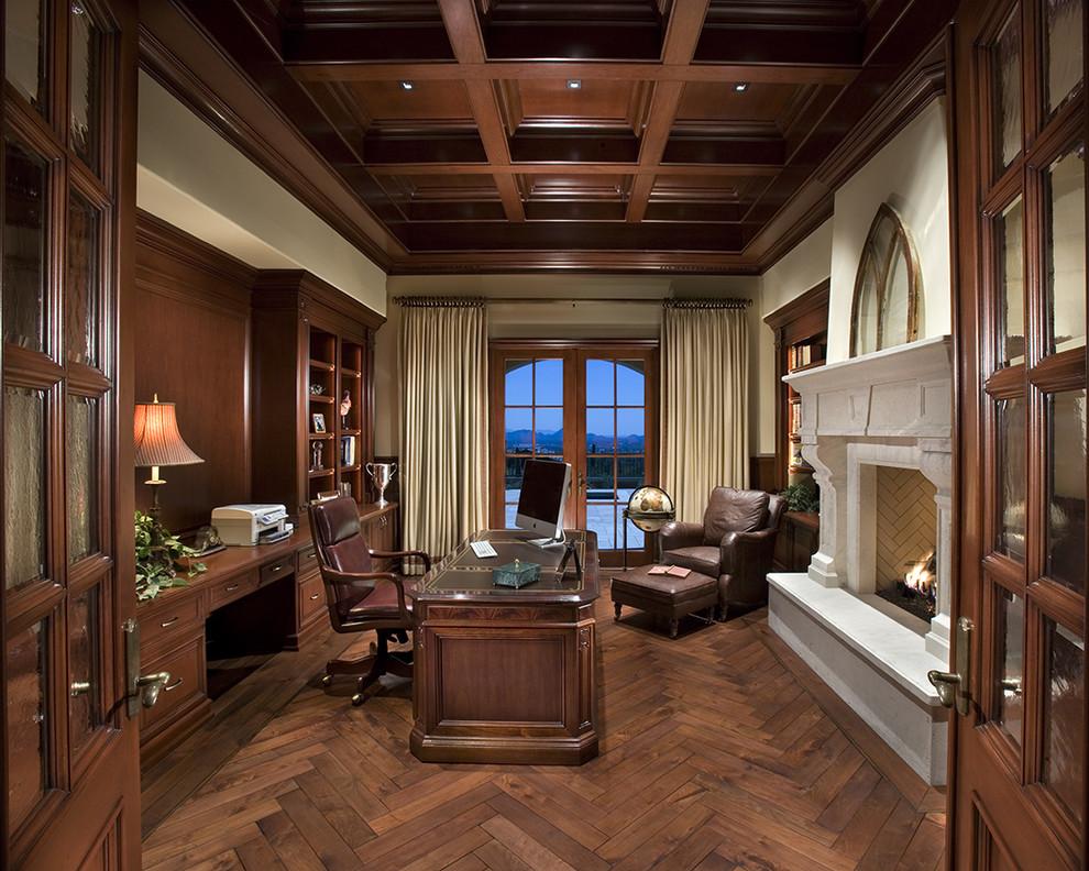 Elegant freestanding desk dark wood floor home office photo in Phoenix
