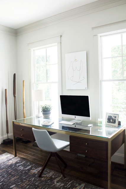 Example of a mid-sized transitional freestanding desk dark wood floor and brown floor home office design in DC Metro with gray walls