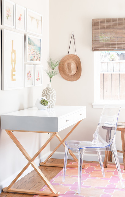 Transitional freestanding desk light wood floor study room photo in Santa Barbara with beige walls