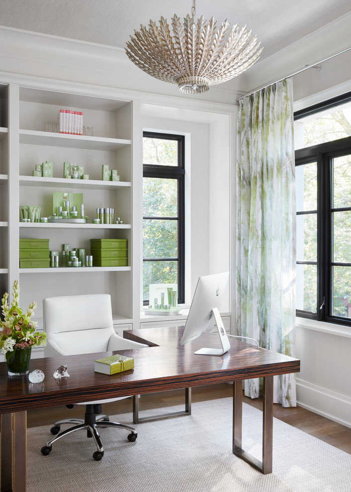 Home office - transitional freestanding desk medium tone wood floor and brown floor home office idea in Chicago with white walls