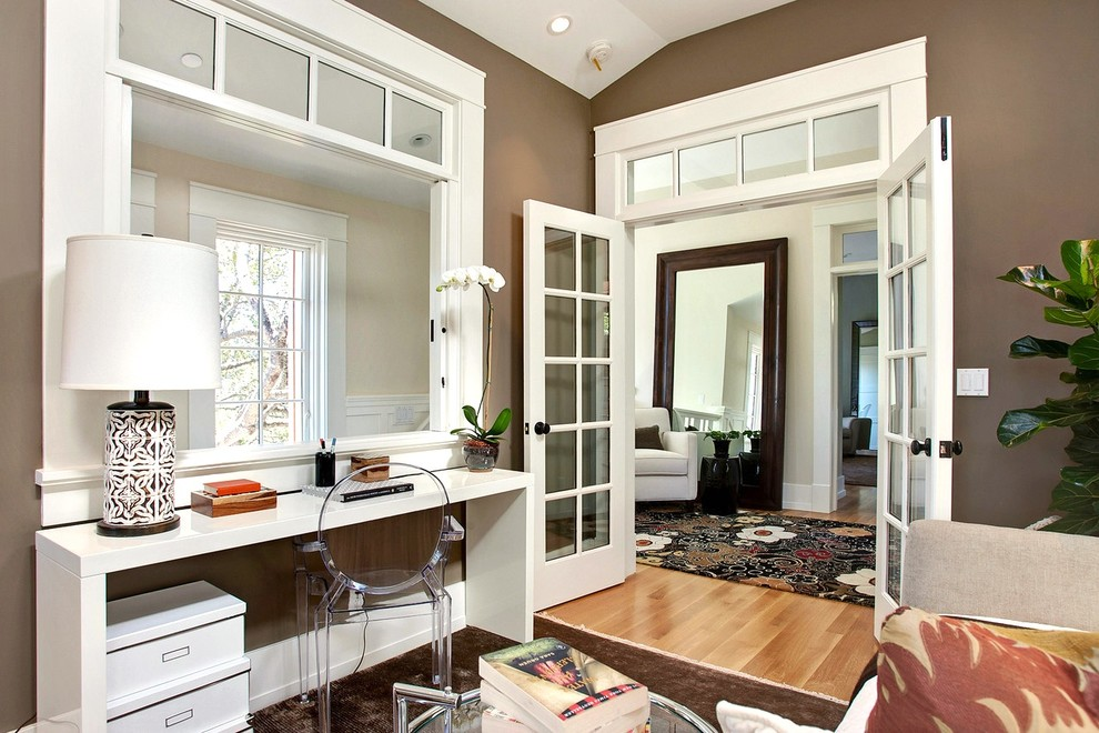 Inspiration for a transitional medium tone wood floor home office remodel in San Francisco with brown walls