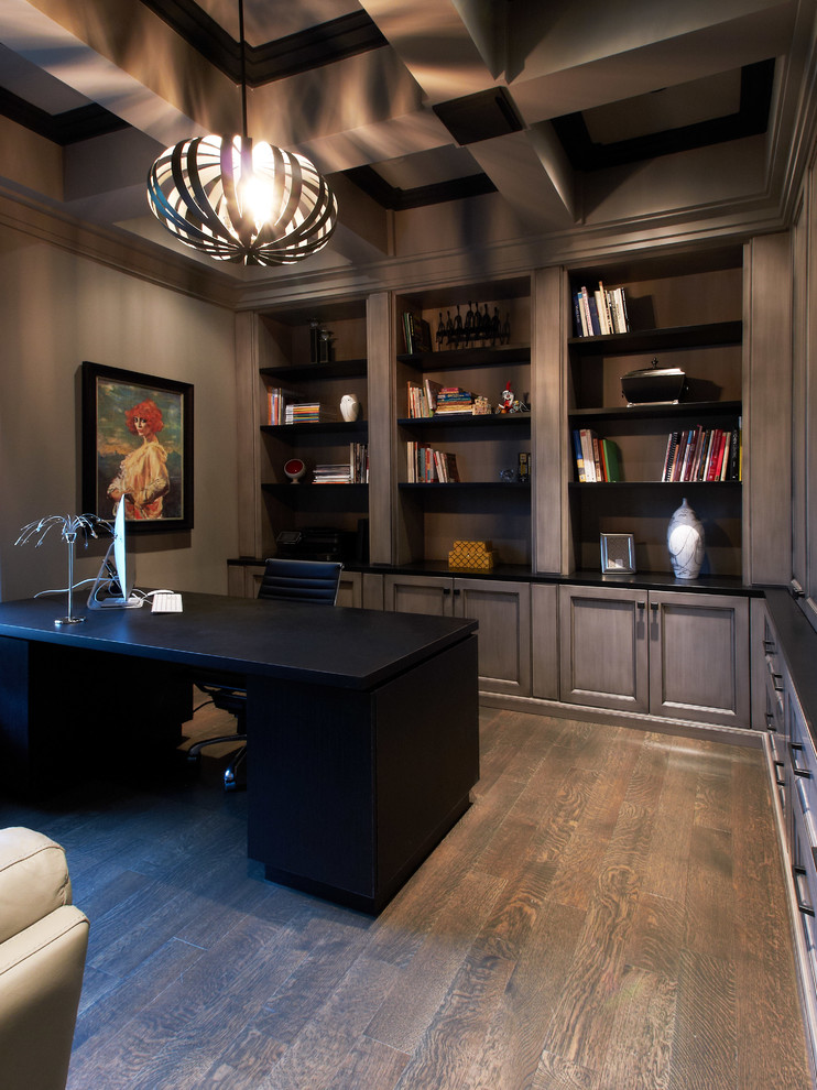 Transitional freestanding desk dark wood floor home office photo in Toronto with gray walls