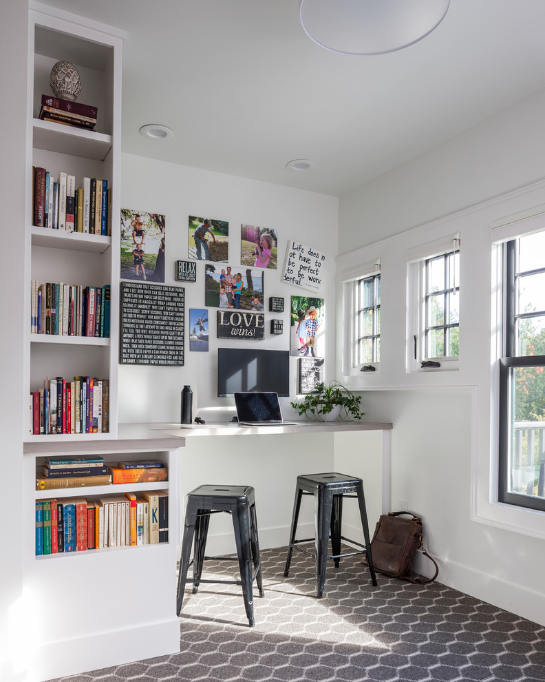 Inspiration for a small transitional built-in desk carpeted and brown floor study room remodel in Seattle with white walls and no fireplace