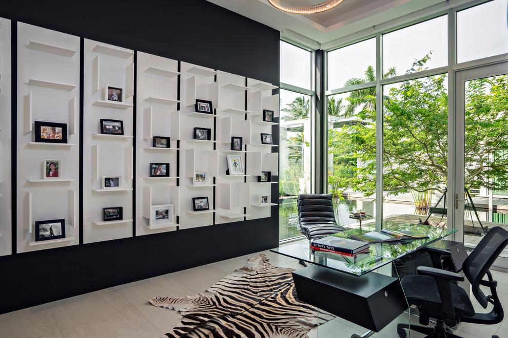 Trendy freestanding desk study room photo in Miami with black walls