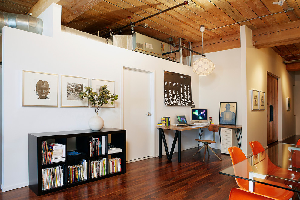 Example of an urban home office design in Los Angeles with white walls