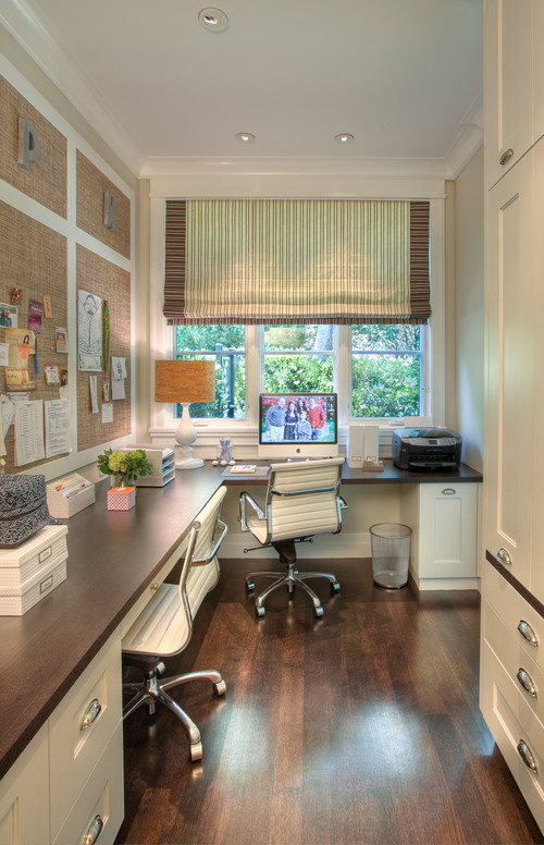 Narrow office area with tons of desk space.