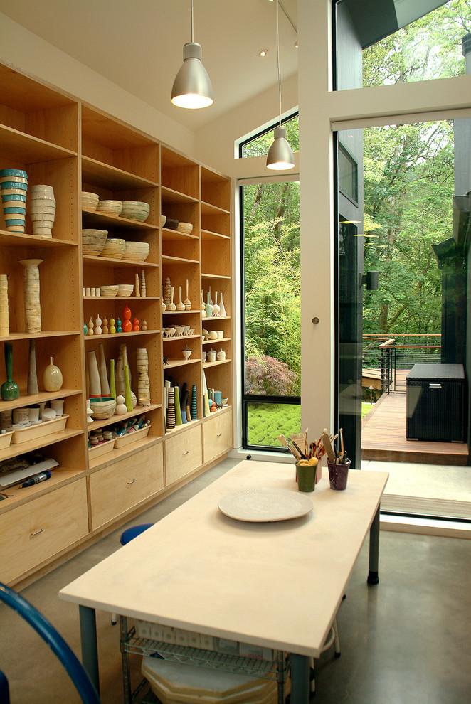 Home studio - contemporary freestanding desk home studio idea in Portland