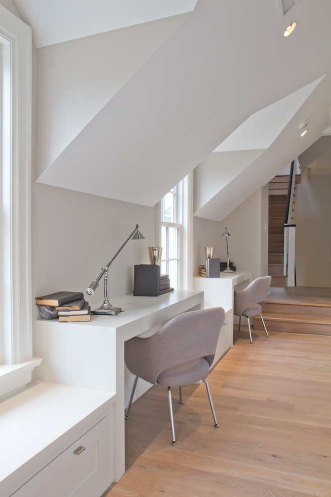 Example of a mid-sized farmhouse built-in desk light wood floor study room design in New York with white walls and no fireplace