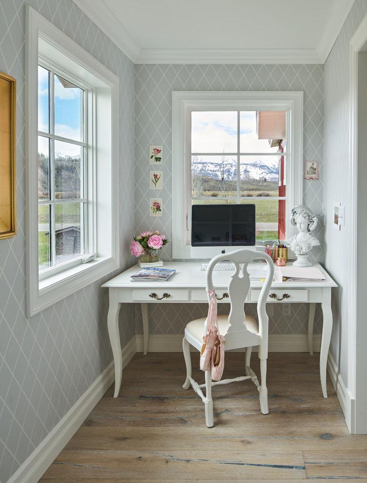 Home office - cottage freestanding desk dark wood floor home office idea in Other with gray walls