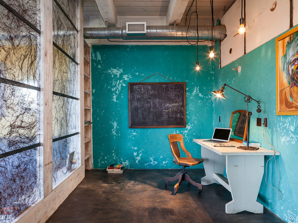 Mid-sized urban freestanding desk concrete floor and black floor study room photo in Portland with blue walls and no fireplace