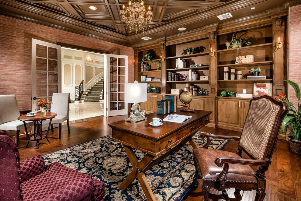traditional home office with wood cabinets