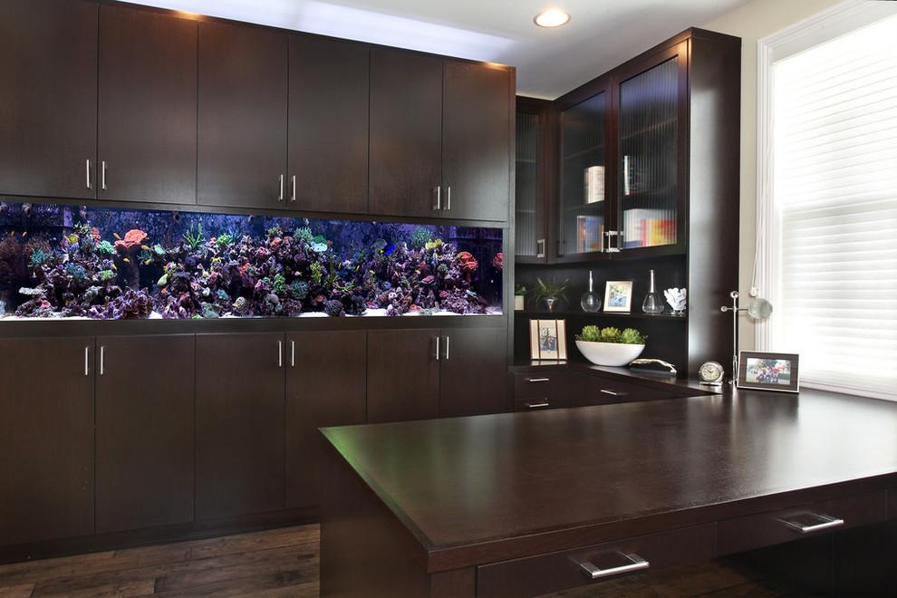 Home office - contemporary built-in desk dark wood floor home office idea in Orange County