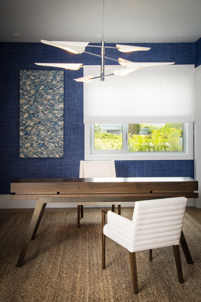 Inspiration for a contemporary freestanding desk home office remodel in New York with blue walls