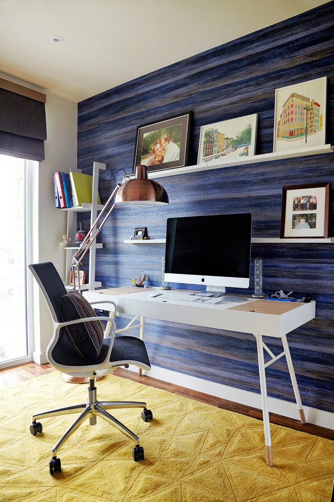 Small minimalist freestanding desk dark wood floor study room photo in London with blue walls and no fireplace